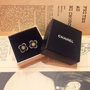 CHANEL black × white earring