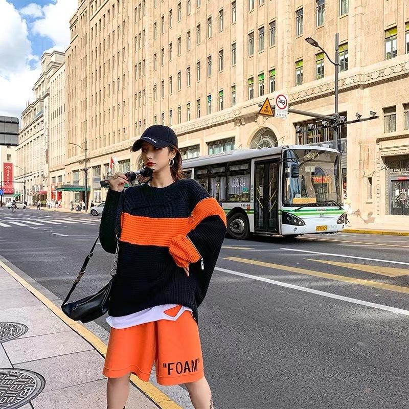 orange line zipper knit