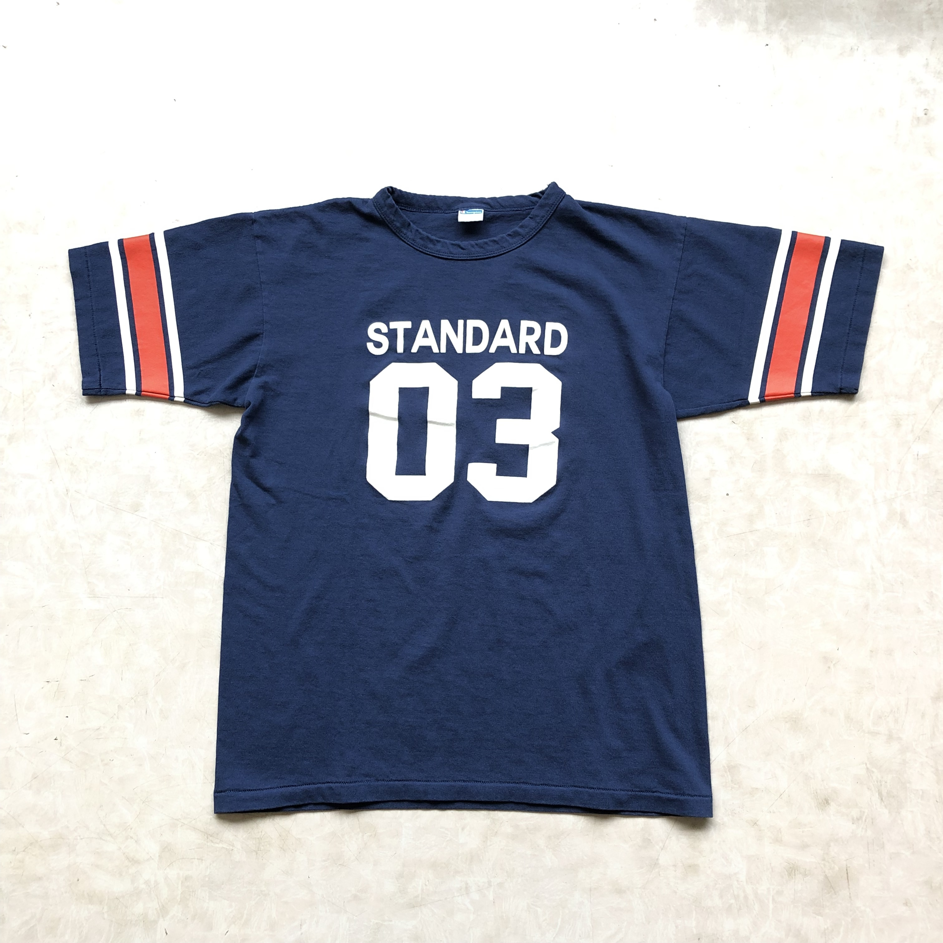 スタンダードカリフォルニア×チャンピオン別注 Champion × SD Win T ネイビー