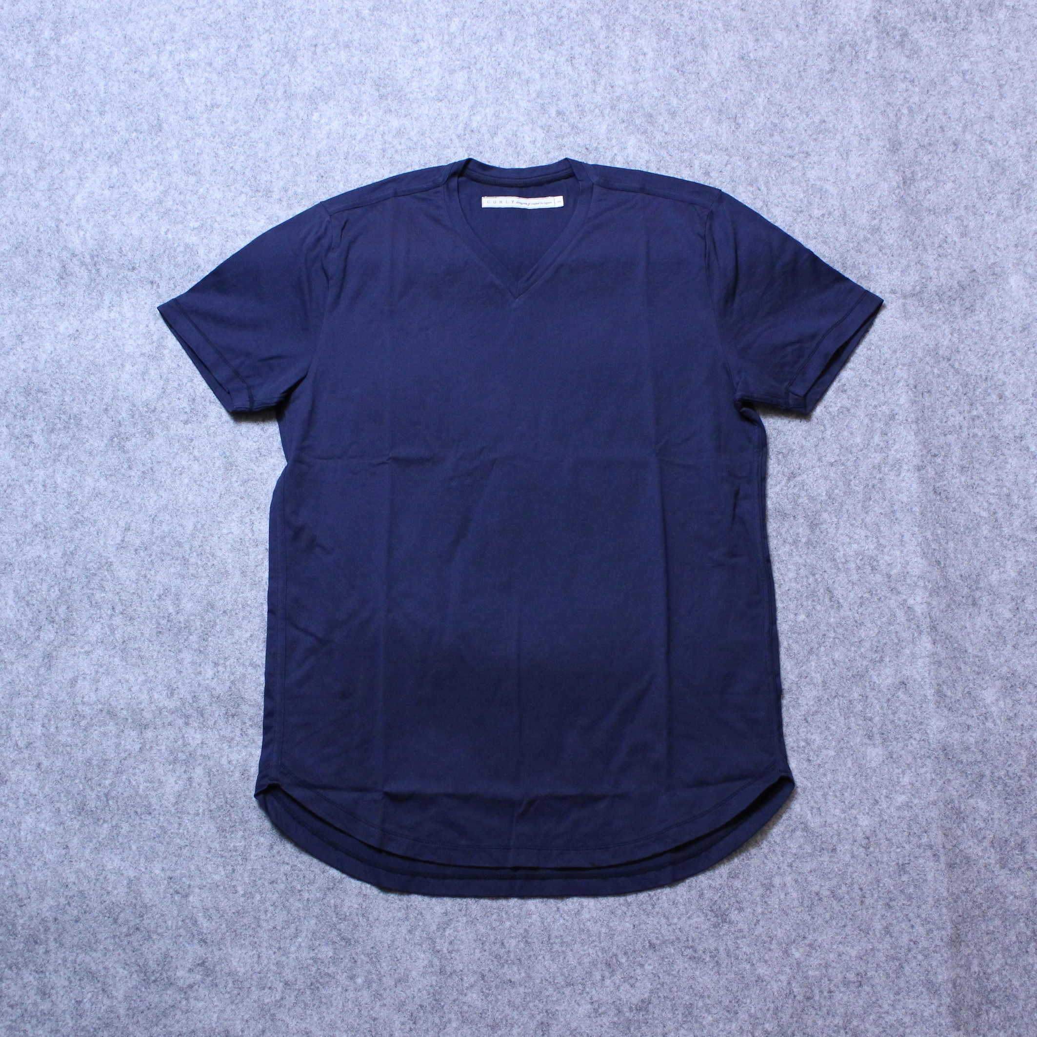 "CURLY(カーリー) ""PPM SS VN TEE"""