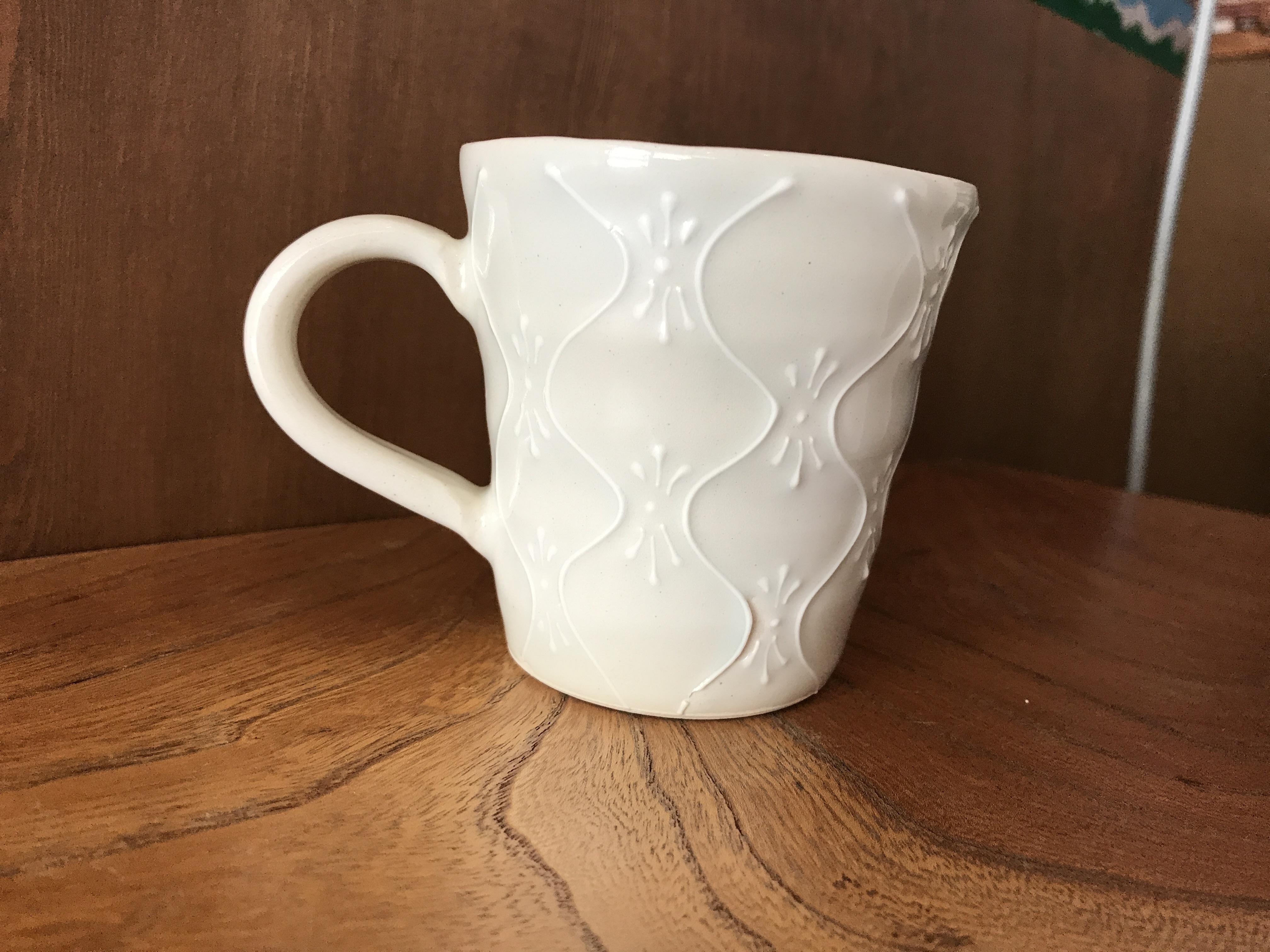 砥部焼 陶彩窯 いっちんのマグカップ