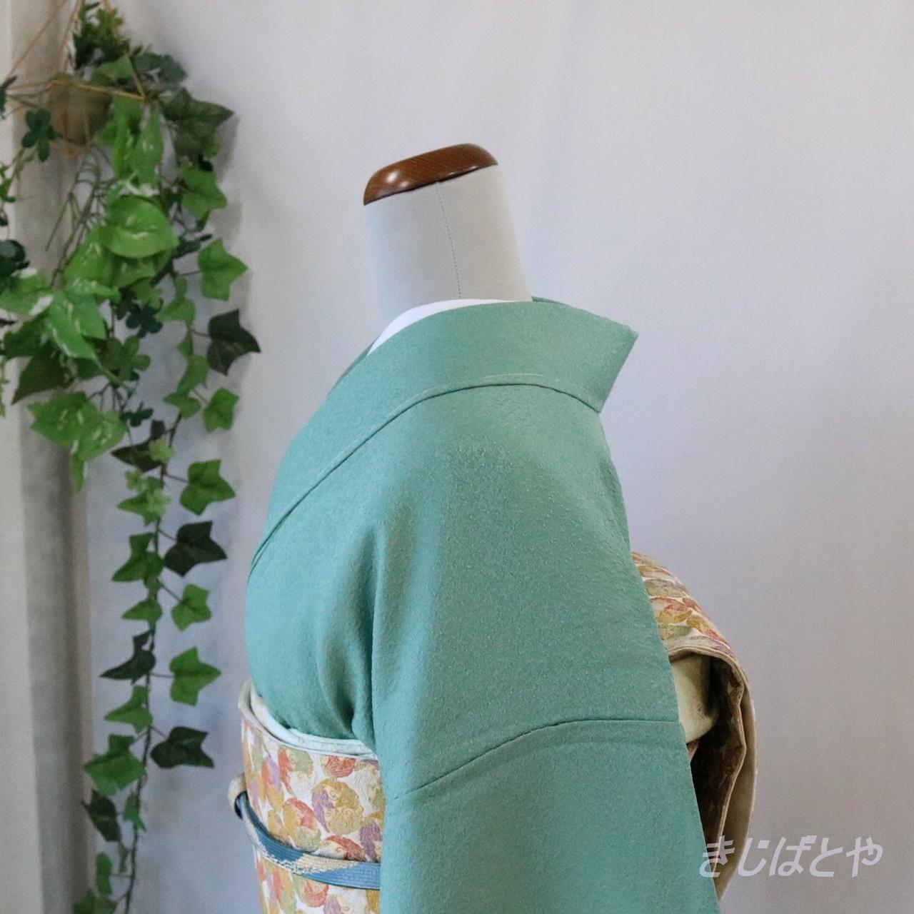 正絹綸子 緑青(ろくしょう)の色無地 紋入り 袷