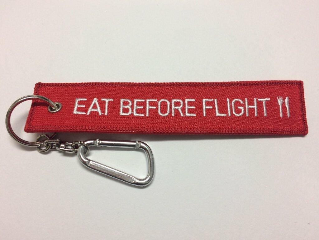 Mobo./「EAT BEFORE FLIGHT」刺繍タグキーホルダー