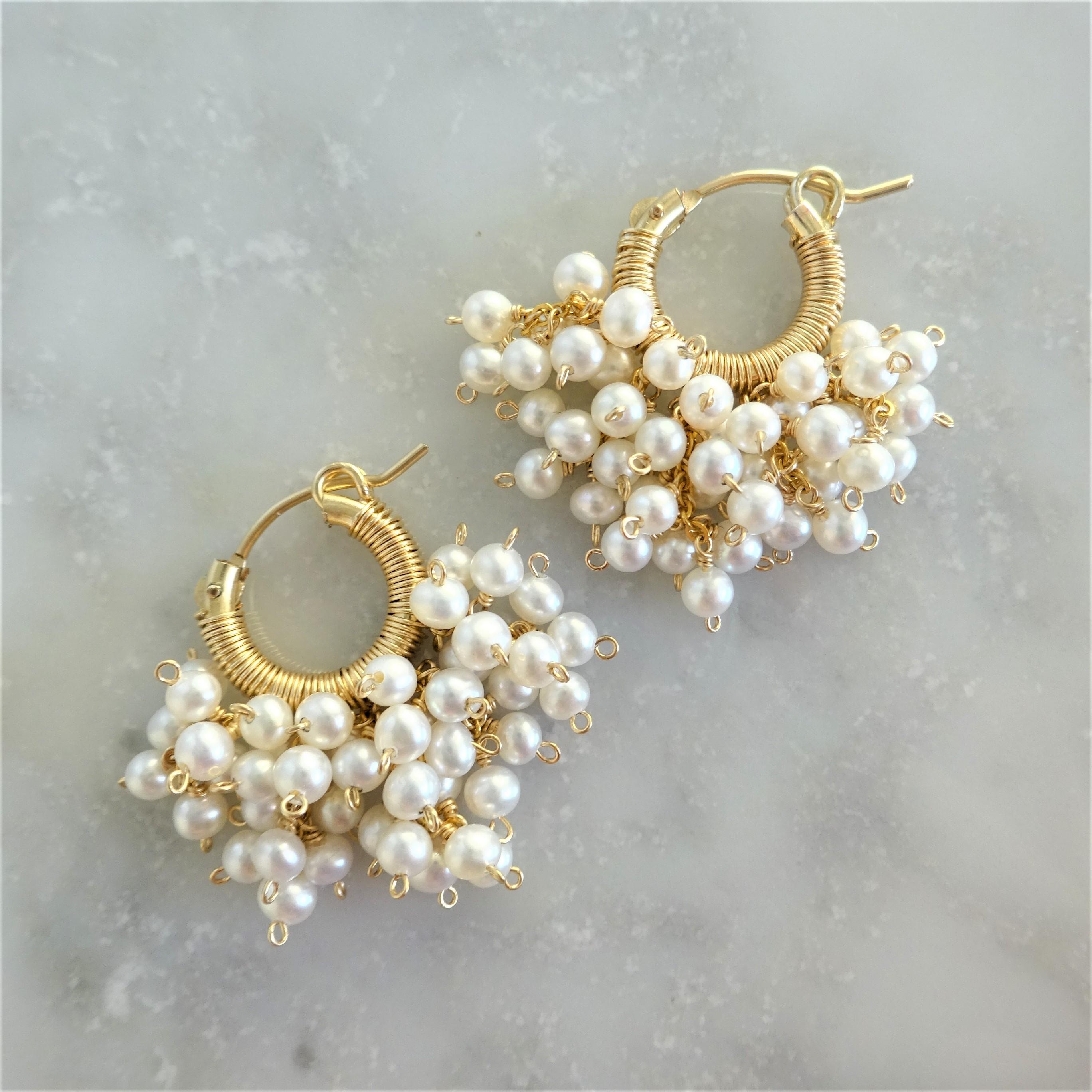 14kgf*AAA volume pearl pierced earring / earring