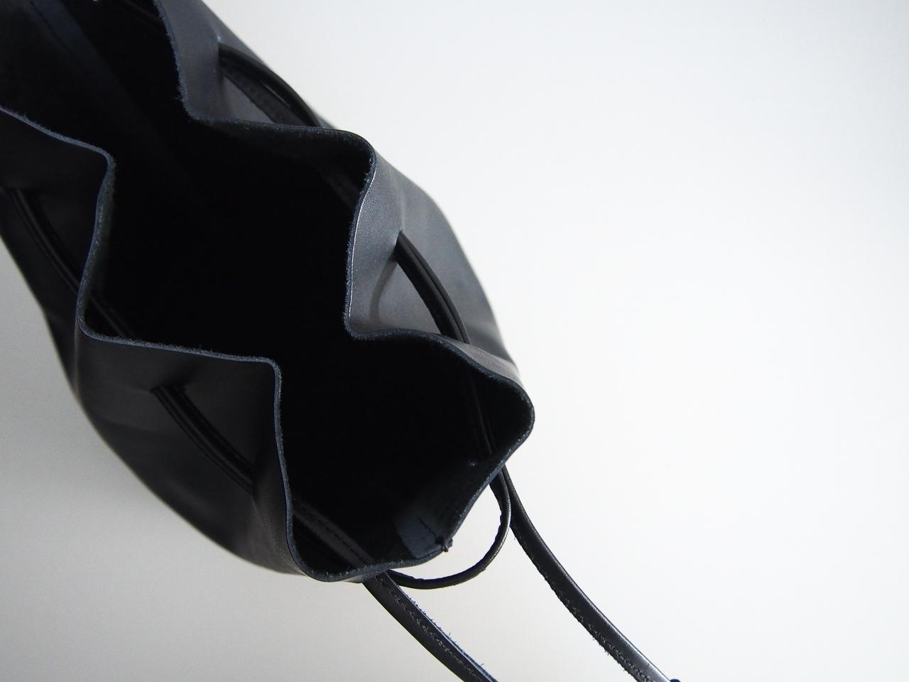 evam eva|drawstring bag