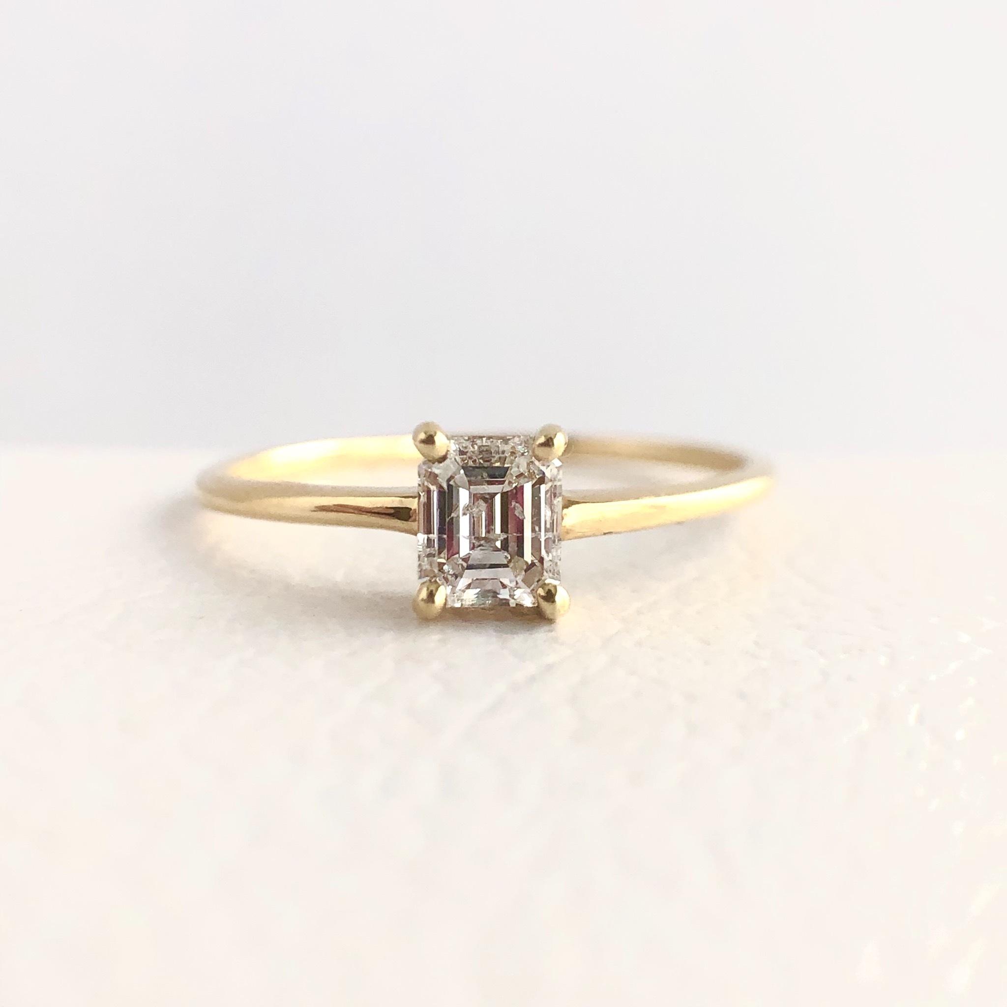 エメラルドカット ダイヤモンド リング 0.28ct  K18イエローゴールド チェカ