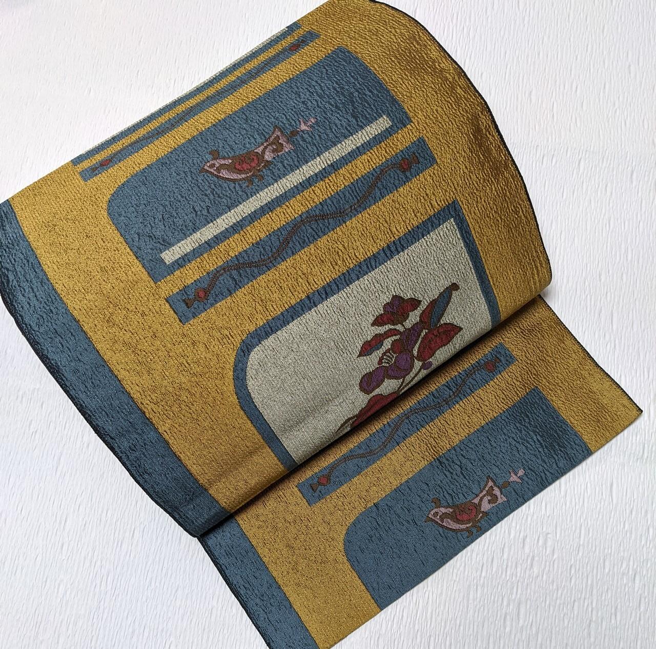 【使用感なし】8寸開き名古屋帯 松葉仕立て 花鳥織出し マスタード×グレー アシメントリー