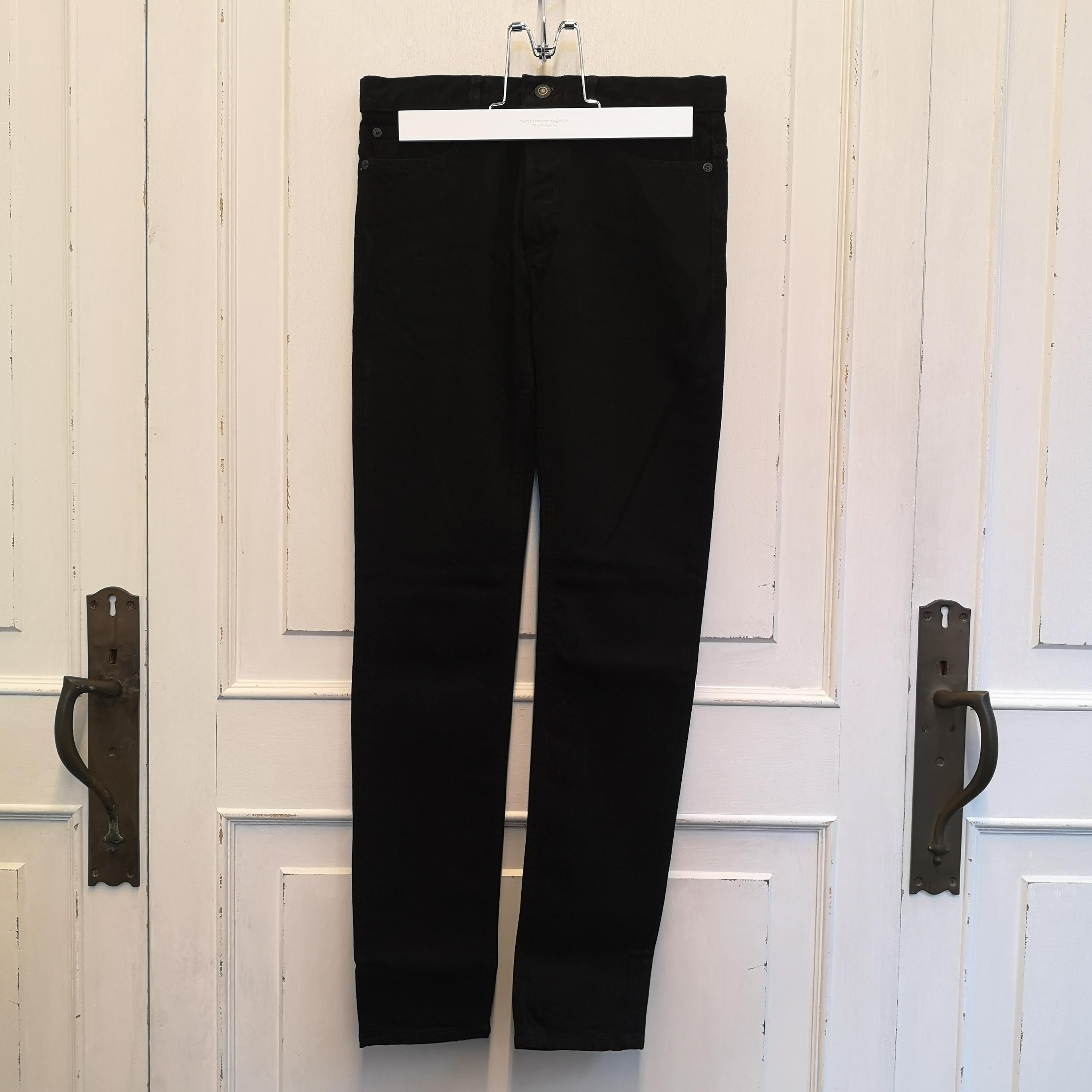 stretch slim tapered 6 pocket jean.