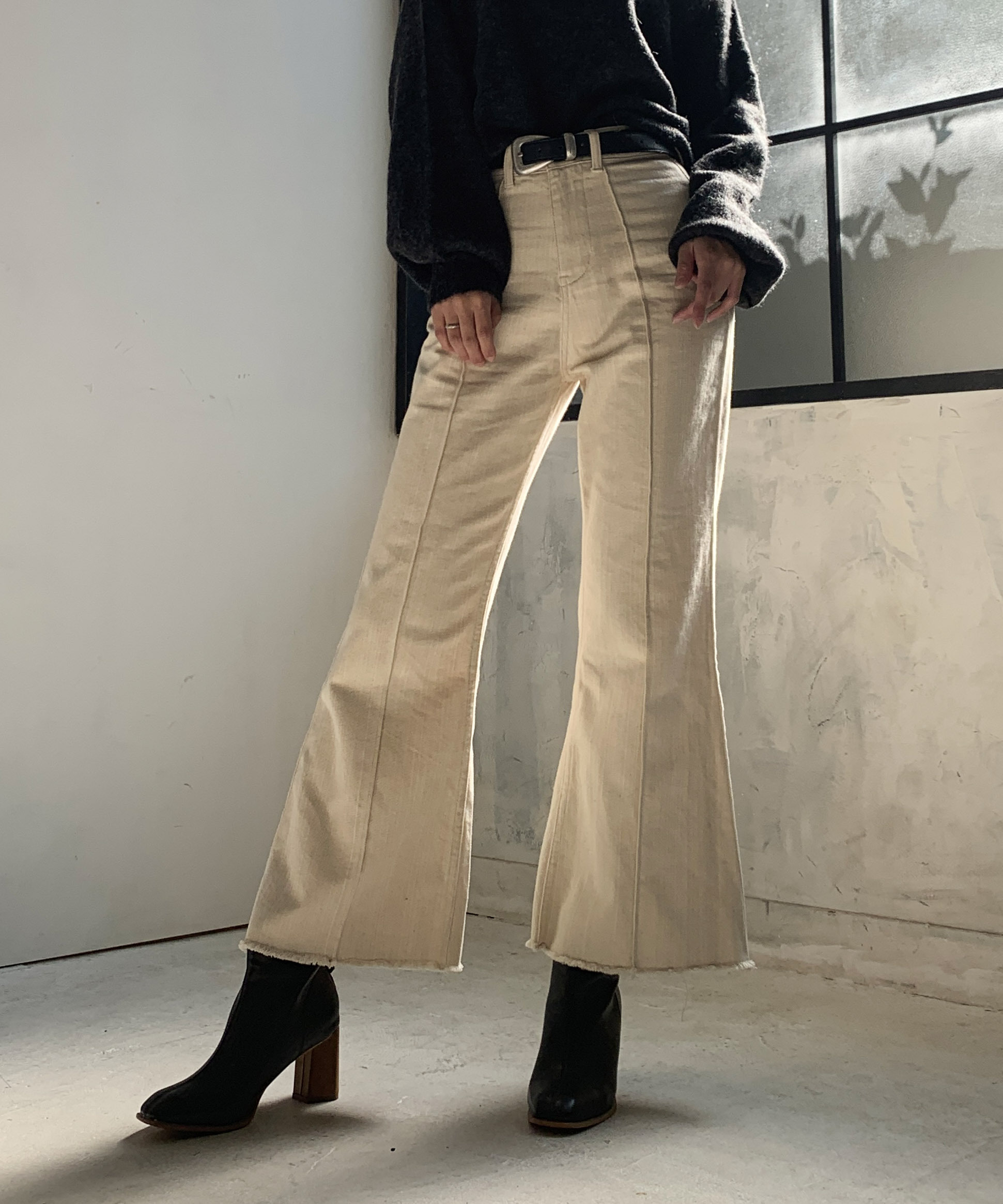 Center tuck flare pants