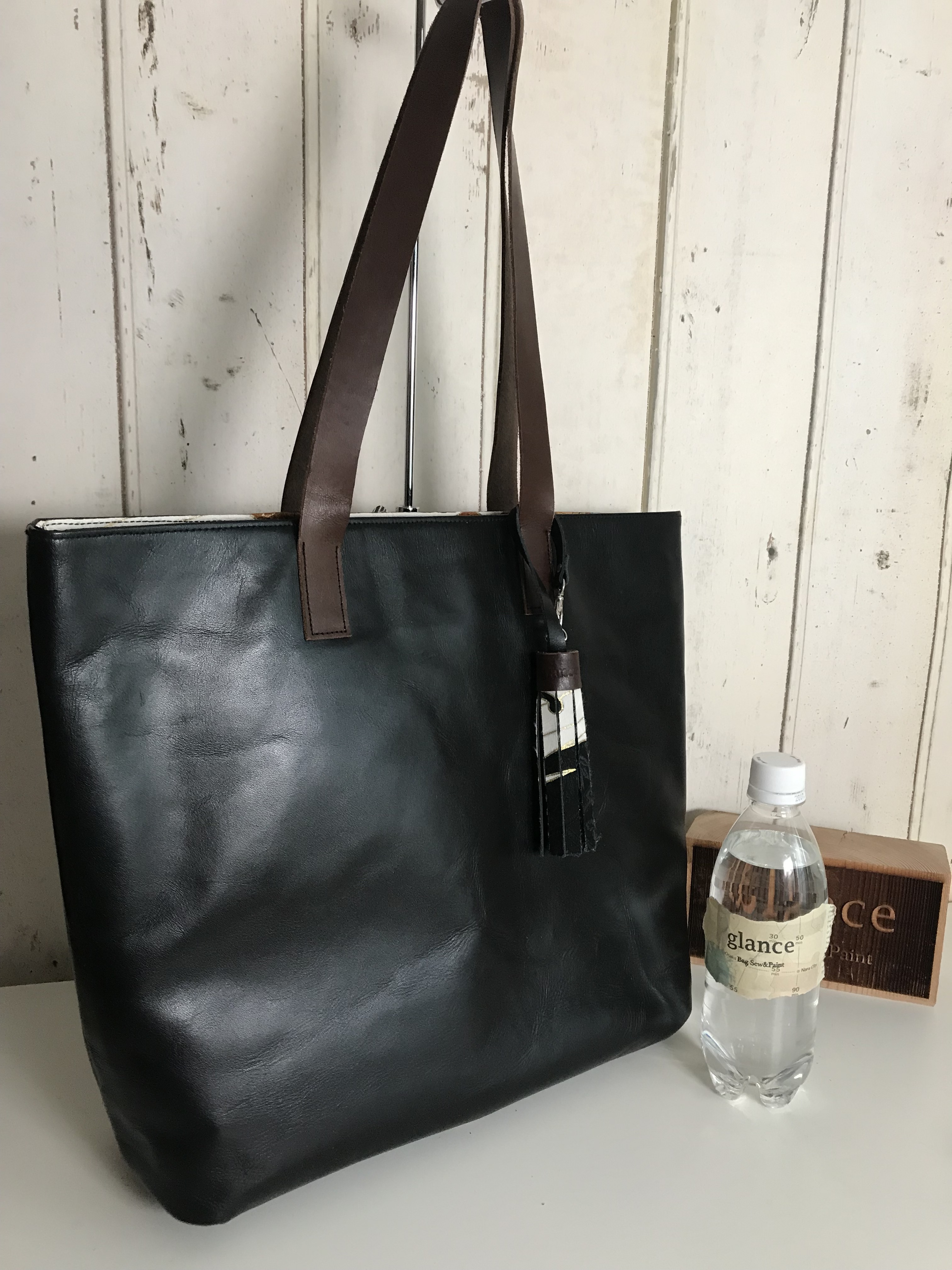 black leather bag / eagle