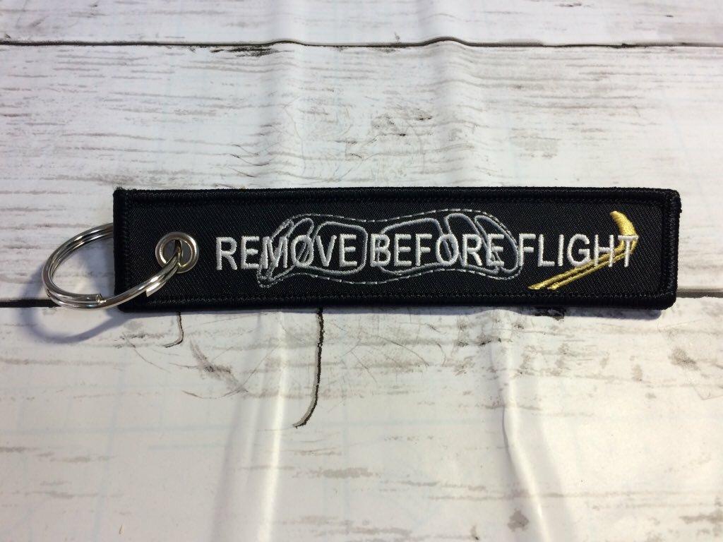 REMOVE BEFORE FLIGHTキーホルダー/A350XWB たぬき目