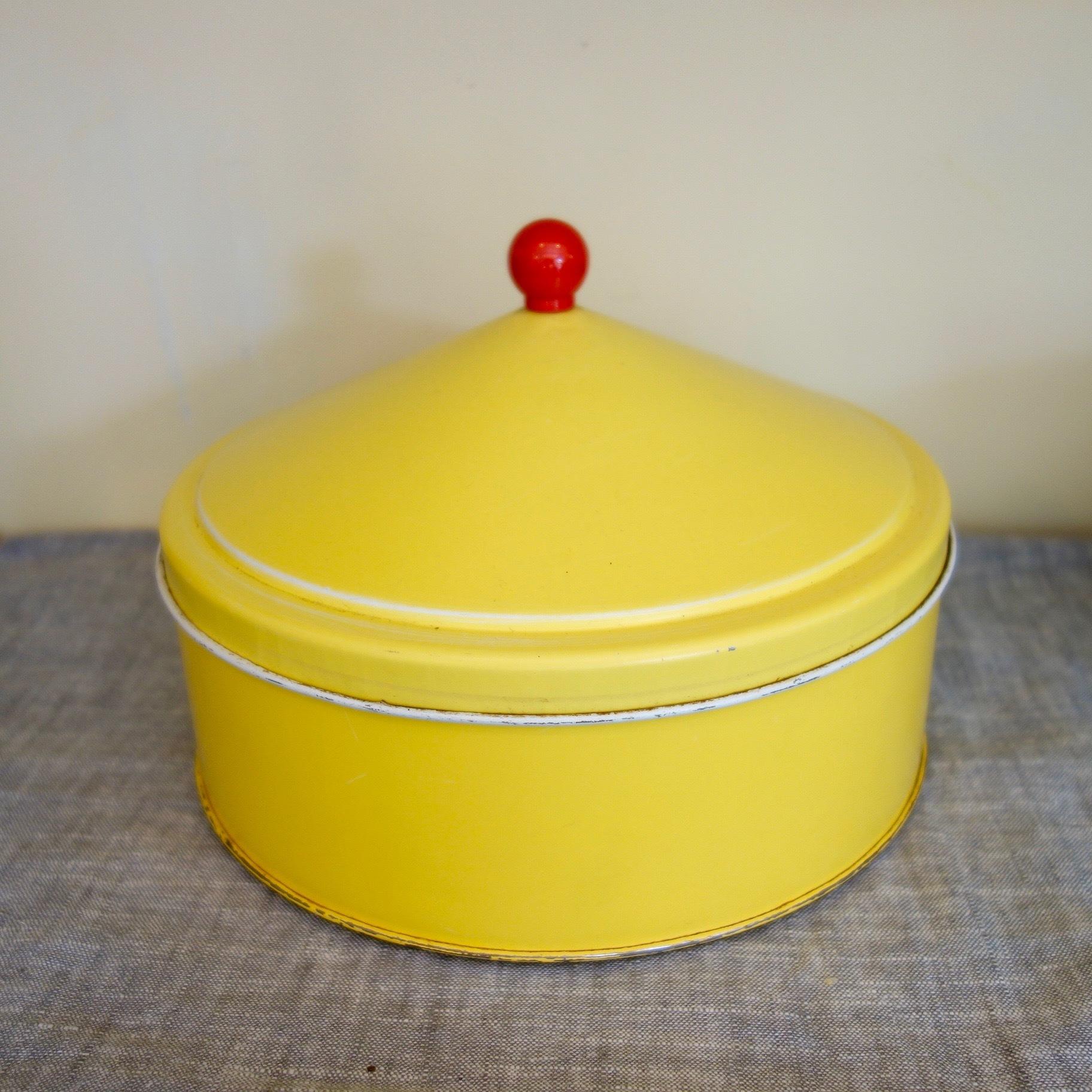 レトロポップなレモンイエロー色のカン