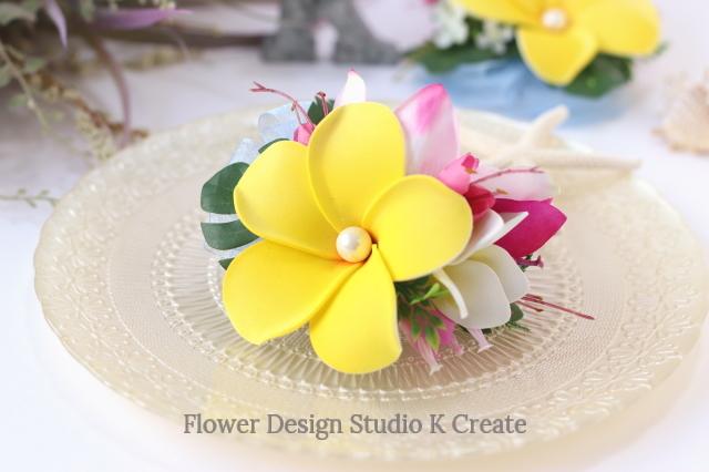 黄色いプルメリアとシンビジュームのヘアクリップ 髪飾り トロピカル 造花 南国 花 フラワー フラ フラダンス