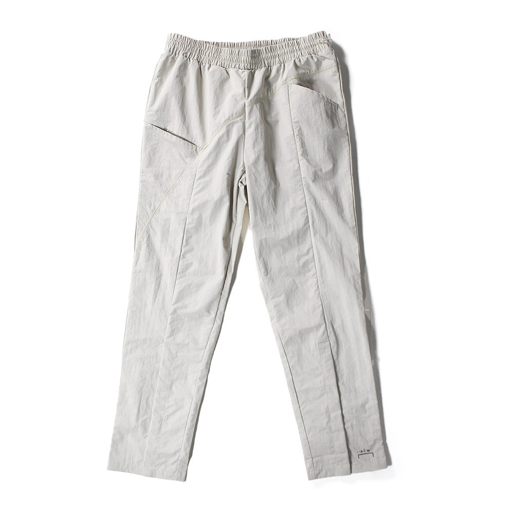 A COLD WALL Front Slit Nylon Trousers Beige