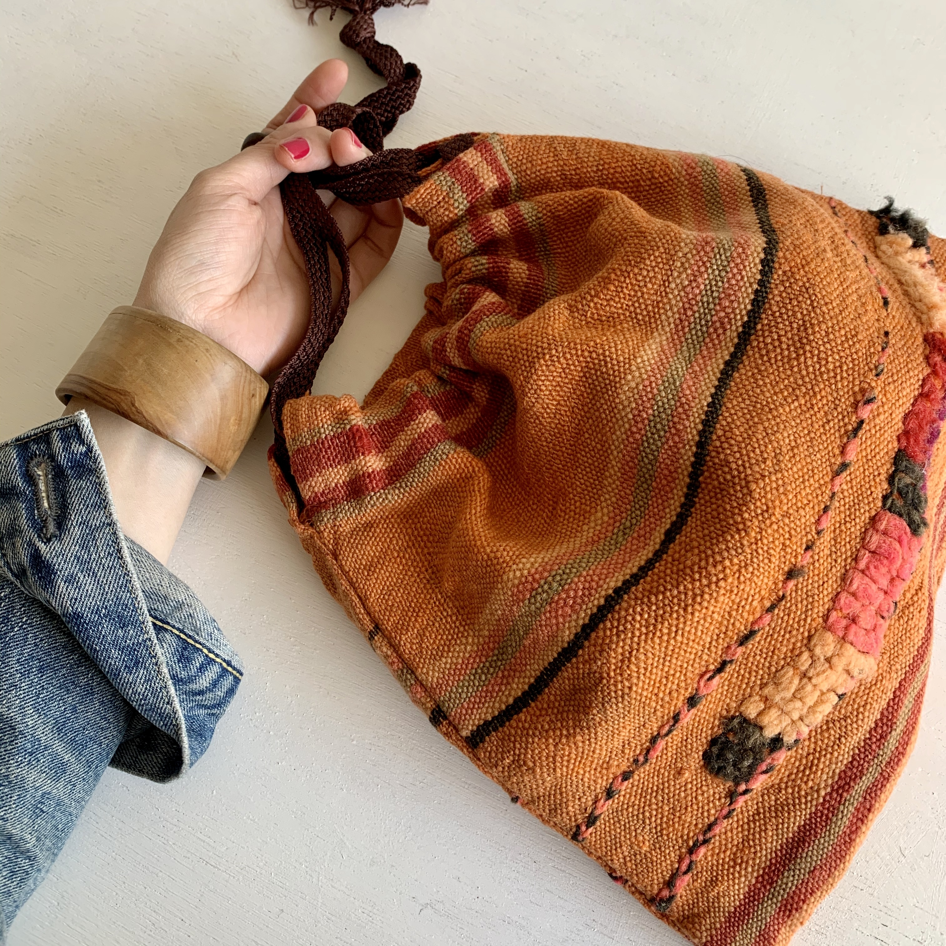 オールドファブリックの巾着バッグ オレンジ