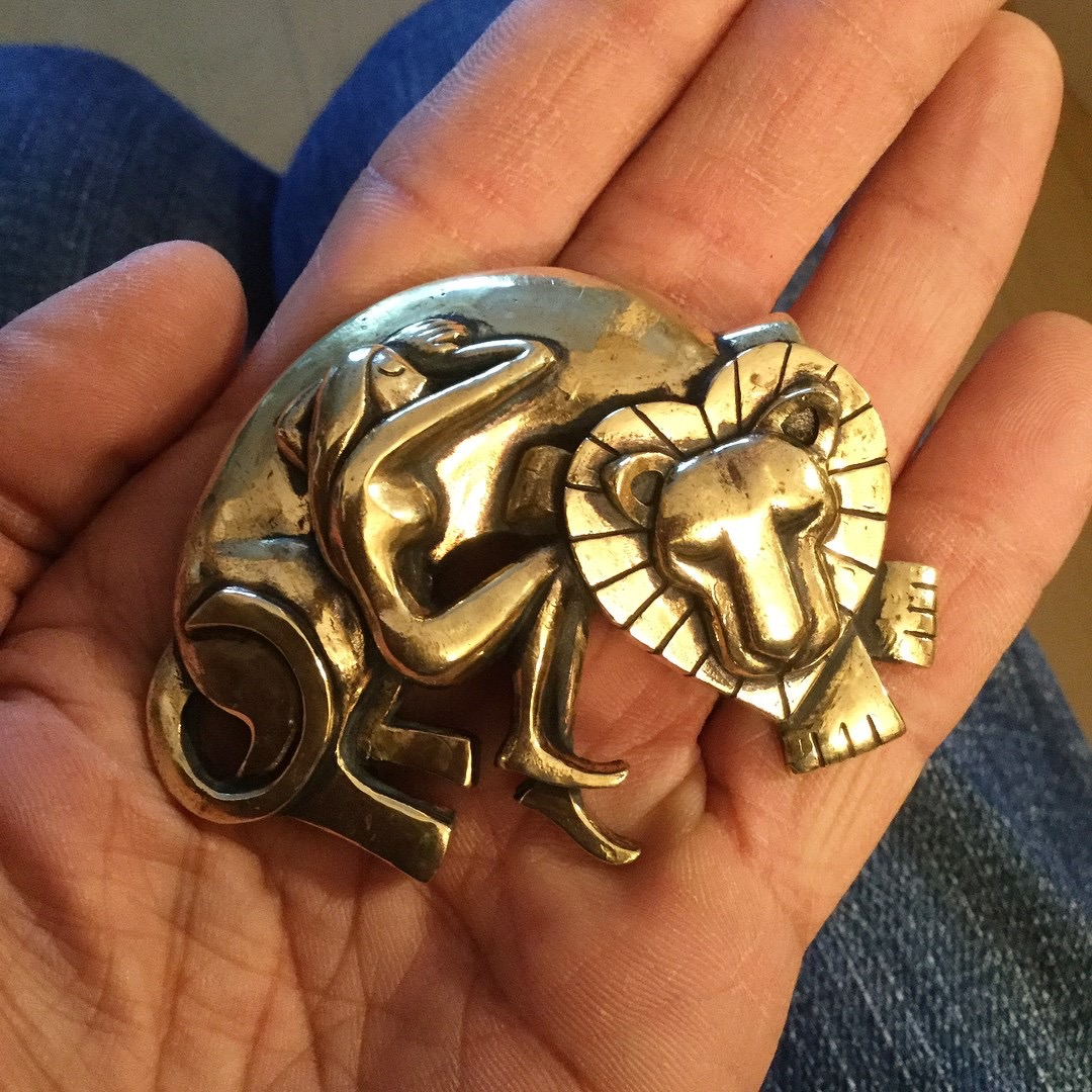 Lion and Woman Paperweight